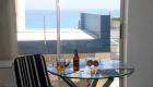 Robben Island. Please improve reflections & flash in door's glass